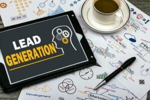Tablet and a cup of coffee on top of many papers that is about lead generation.